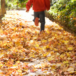 Kid-running-in-leaves-GA
